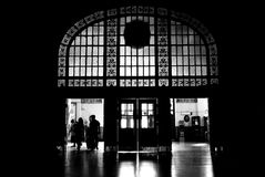 Silhouette people. Black silhouette of the people leaving dark lobby. traditional architecture Stock Photography