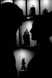 Silhouette of people against wine jugs. The girl looks at the guy against wine jugs. Silhouette photo. Monochrome Royalty Free Stock Photo