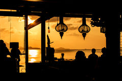 Silhouette of people at bar Stock Photography