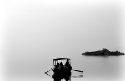 Silhouette of people in Boat. Black and white Silhouette of people in a boat. Taken in India Stock Image