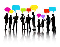 Silhouette People Communication with Speech Bubbles Stock Photo