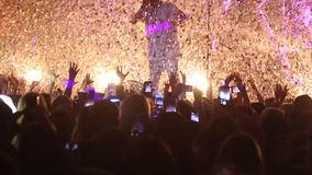 Silhouette people in a crowd with hands up dancing. Concert crowd at live music festival stock video footage