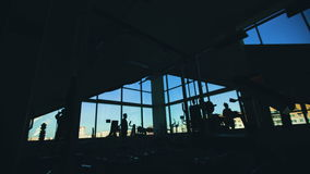 Silhouette of people doing exercise in fitness club and gym center stock footage