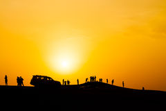 Silhouette of people in dubai desert, with sunset. Royalty Free Stock Photography