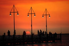 Silhouette of people families fishing at sunset in summer Royalty Free Stock Photography