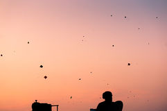 Silhouette of people flying kites Royalty Free Stock Photo