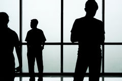 Silhouette of people in front of glass wall background, abstract image Stock Image