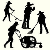 Silhouette of people gardening Royalty Free Stock Photo