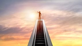 Silhouette of people and Golden Medal on top of escalator with sunset, concept as shampion or winner in bussiness. Silhouette of people and Golden Medal on top stock photos