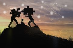 Silhouette people helping to connect jigsaw. And puzzle to success, concept as improving and development business stock photo