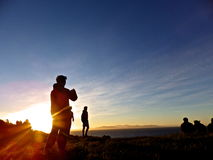 Silhouette of People on Hill Stock Images