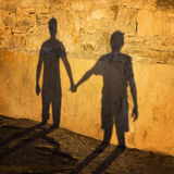 Silhouette of people holding hands Royalty Free Stock Images