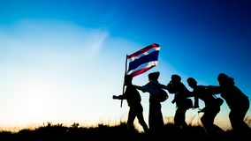 Silhouette of people holding Thailand flag and Move forward stock photo