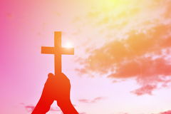 Silhouette people jesus and cross Stock Images