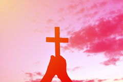 Silhouette people jesus and cross. At sunset Stock Photo