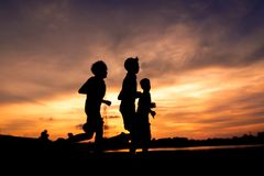 Silhouette of people jogging for exercise Stock Photography
