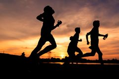 Silhouette of people jogging for exercise. In park at sunset,Silhouette sporty image concept. 22-09-2017,Udonthani ,Thailand Asia Stock Photography