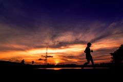 Silhouette of people jogging for exercise Stock Image