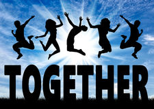 Silhouette people jumping over the word together Stock Photo