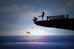 Silhouette of people kick impossible Stock Image