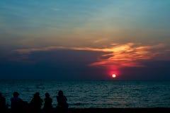 silhouette people look sunset sky on beach stock photo