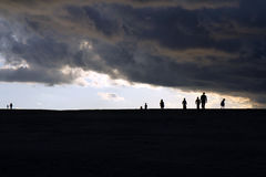 Silhouette of People on Mountain Stock Images