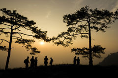 Silhouette people on mountain at sunrise Stock Images