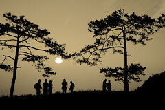Silhouette people on mountain at sunrise Royalty Free Stock Image