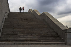Silhouette of people moving on stairs,. Silhouette of people moving on granite stairs Stock Image