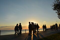 Silhouette of People Near Seashore during Sunset Stock Image