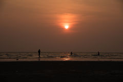 Silhouette people playing on beach Royalty Free Stock Photo