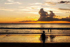Silhouette people relax on the beach Stock Photo