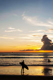 Silhouette people relax on the beach Stock Photos