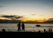 Silhouette people relax on the beach Royalty Free Stock Photo