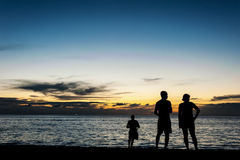 Silhouette people relax on the beach Stock Images