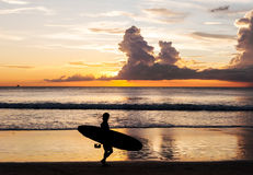 Silhouette people relax on the beach sunset Stock Photos