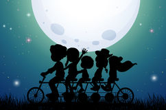 Silhouette people riding bike at night Royalty Free Stock Image