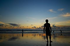 Silhouette people at the sea. Stock Photo