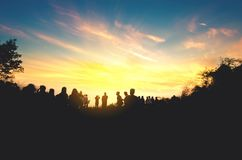 Silhouette people see sunset in the morning. Background Stock Photo