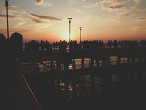 Silhouette of People Standing on Bridge during Sunset Stock Images
