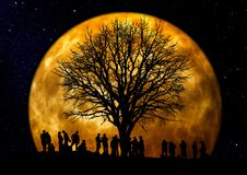 Silhouette of People Standing Neat Tree Under the Moon Royalty Free Stock Photos