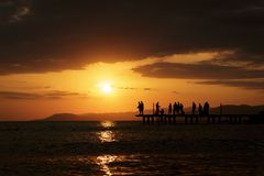 Silhouette of people at sunset royalty free stock photo