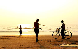 Silhouette of people during sunset in Arambol Beach, Goa India. Royalty Free Stock Image