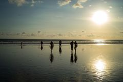 Silhouette people in Sunset time at Kuta Beach, Bali-Indonesia. Love to hang out in kuta beach at sunset time. Kuta beach is one favorite place to be visited stock images