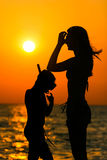 Silhouette of people at sunset Royalty Free Stock Photos