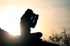 Silhouette of people taking pictures against the setting sun. The silhouette of people taking pictures against the setting sun Royalty Free Stock Images