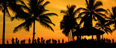 Silhouette of people and tourist during a beautiful sunset Royalty Free Stock Image