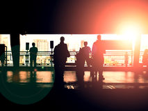 Silhouette of people at train& x27;s platform with backlight Stock Photos