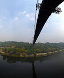 Silhouette of people traveling across bridge Stock Image