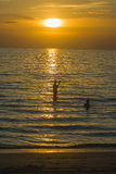 Silhouette of people and tropical view of sea with sunset light at Chao Lao Beach. Royalty Free Stock Image